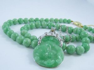 Green jade necklace and pendant with gold and diamonds with Chinese carving