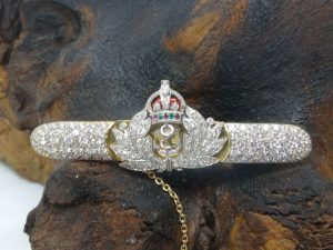 Gold Naval Crown Brooch with diamonds emeralds and rubies