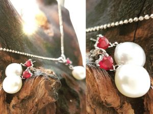 Heart shaped Ruby and White pearl earring and pendant set in 18 carat white gold