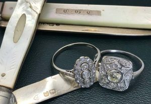 art deco engagement ring in platinum 18ct gold with old-cut diamonds and sterling silver pocket knife