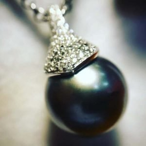 Black Pearl and Diamond Pendant in 18ct white gold