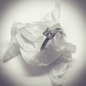 1 carat excellent radiant cut solitaire diamond engagement ring with 4 claws and diamond set band in 18ct gold