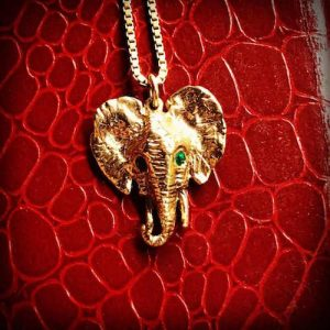 18 carat gold elephant pendant set with natural Colombian emeralds