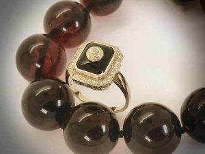 vintage art deco gold diamond and onyx ring, cherry Baltic amber bead necklace