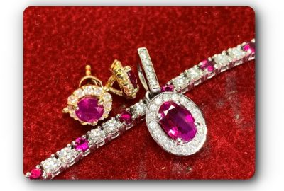 18ct Ruby and diamond tennis bracelet with matching diamond and ruby pendant and yellow gold earrings set